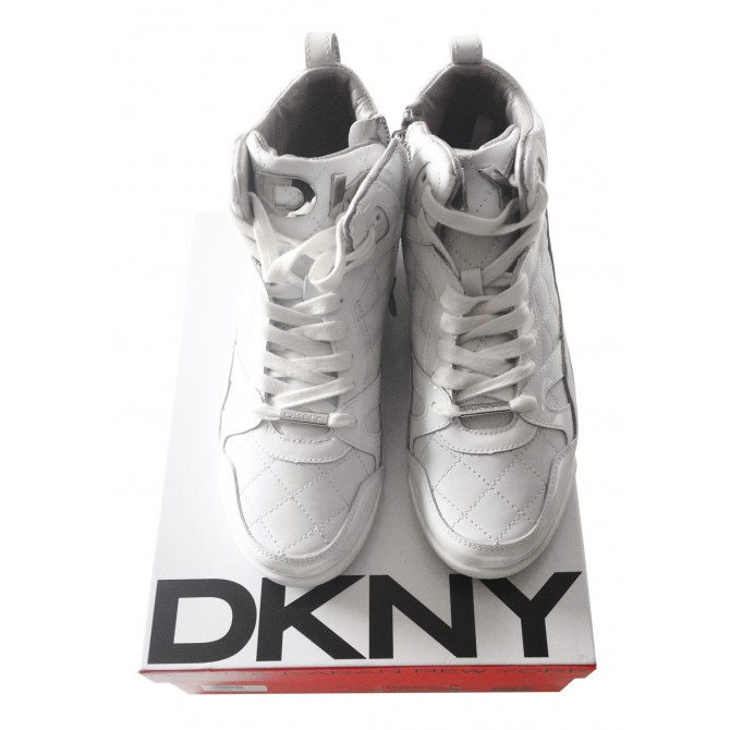 DKNY white leather sneakers.