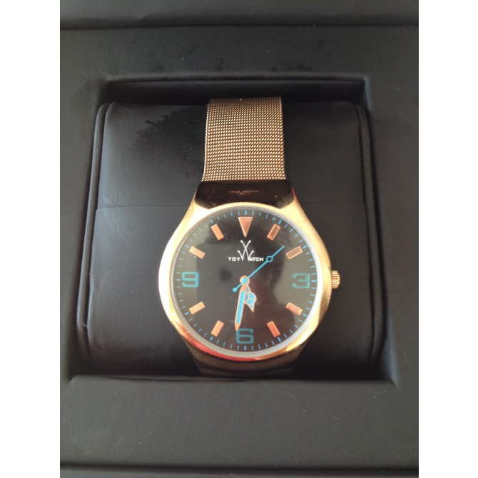 Toy Watch rose gold  color watch with black  dial and blue clockwise