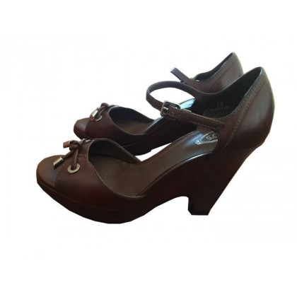 Tod's platform heeled sandals in brown leather