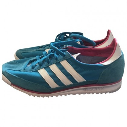 Adidas Turquoise with white stripes trainers