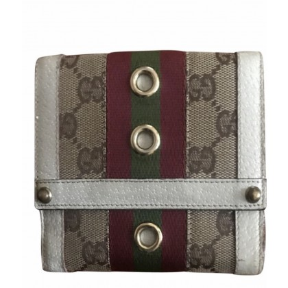 Gucci logo print fabric and beige leather wallet