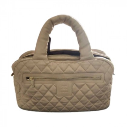 CHANEL Coco Cocoon beige/gold quilted leather bag